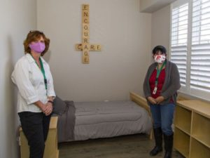 Brant County Safe Beds manager Kim Dillon (left) and team lead Maureen Acuna-Harrison show one of seven bedrooms at the new facility located at 84 Brant Ave. in Brantford. BRIAN THOMPSON / THE EXPOSITOR